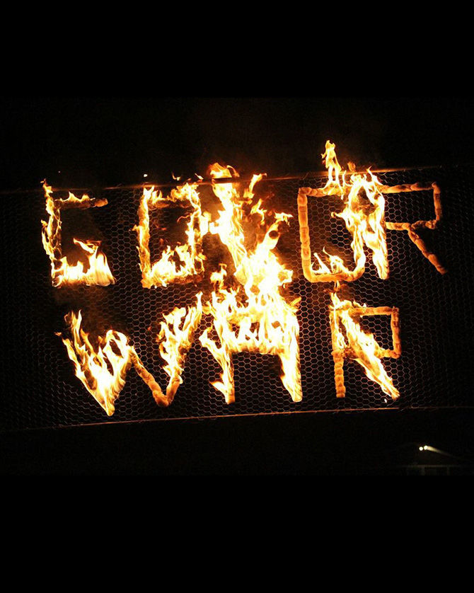 The flaming Color War sign burns brightly
