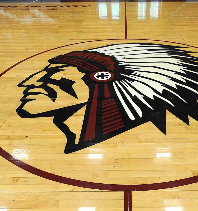 Manitou logo on basketball court