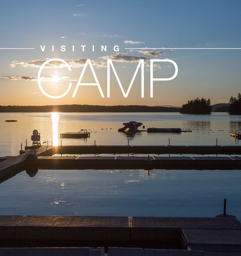 The sun sets over the lake at Camp Manitou