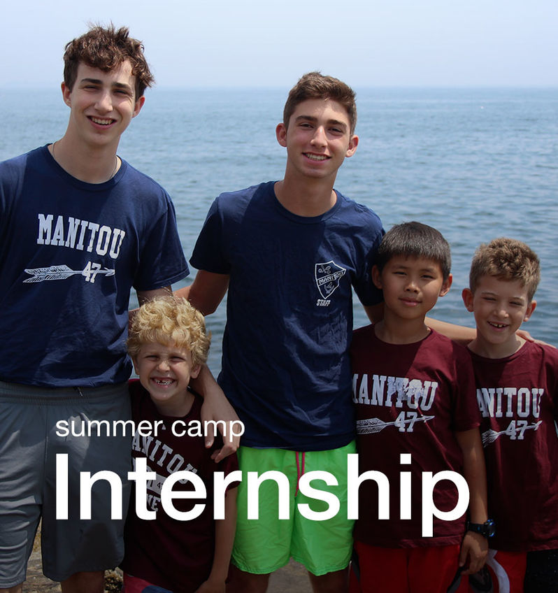 Counselors and interns with campers at the coast of Maine